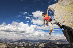 Rock climber clinging to a cliff. Royalty Free Stock Images