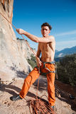 Rock climber collecting belay rope over the mountains Stock Images