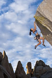 Rock climber dangling. Royalty Free Stock Photos