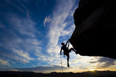 Rock climber dangling. Stock Images