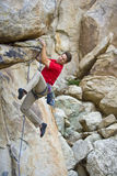 Rock climber dangling from a cliff. Royalty Free Stock Images