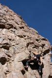 Rock climber in dyno move Royalty Free Stock Photos