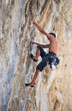 Rock climber on face of a cliff Stock Images