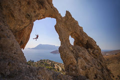 Rock climber falling of a cliff while lead climbing. Kalymnos Island, Greece Royalty Free Stock Photography