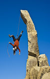 Rock climber falling upside down. Stock Photo
