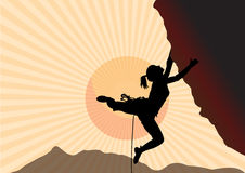 The rock-climber the girl rises up by the mountain. The climber against mountains at sunrise makes rise on height.  Stock Photo
