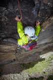 Rock climber girl on steep wall Stock Images