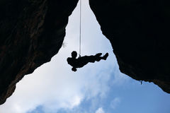 Rock climber going down from the top of route Royalty Free Stock Images