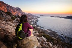 Rock climber having rest at sunset Royalty Free Stock Image