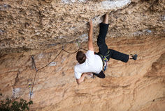 Rock climber on his challenging way up. View from above Royalty Free Stock Photography