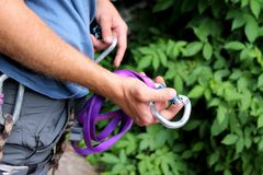 Rock climber holding carabiner Stock Images