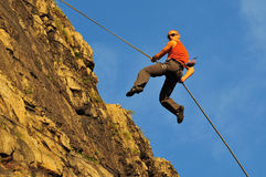 Rock climber jumping Royalty Free Stock Photography