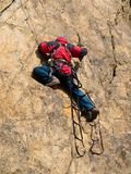 Rock climber at ladder. Rock climber climbing at ladder on the rock at mountaineering competition Stock Photos