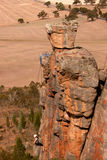 Rock Climber at Mt Arapiles. Rock Climber Abseiling down Rock Stack at Mt Arapiles in Australia Stock Photography