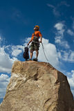 Rock climber nearing the summit. Royalty Free Stock Image