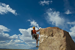Rock climber nearing the summit. Royalty Free Stock Photo
