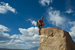 Rock climber nearing the summit. Stock Images
