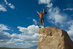 Rock climber nearing the summit. Royalty Free Stock Photography