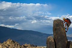 Rock climber nearing the summit. Stock Photography