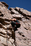 Rock climber nearing top Royalty Free Stock Images
