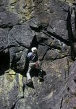 Rock climber on overhang Stock Photography