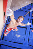 Rock climber participating in climbing competition Royalty Free Stock Photo