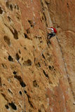 Rock climber on potholes route Royalty Free Stock Photography