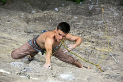 Rock climber preparing to the next move Royalty Free Stock Photos
