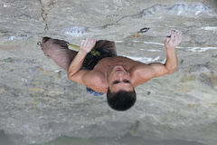 Rock climber preparing to the next move Stock Images