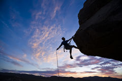 Rock Climber Rappelling. Stock Photos