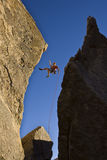 Rock climber rappelling. Royalty Free Stock Photos