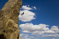 Rock climber rappelling. Royalty Free Stock Images