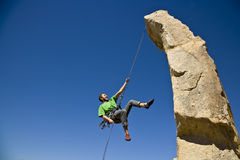 Free Rock Climber Rappelling. Royalty Free Stock Images - 6371429