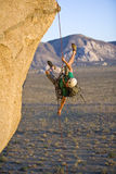 Rock climber rappelling. Royalty Free Stock Photography