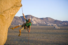 Rock climber rappelling. Stock Photography