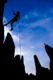 Rock climber rappelling. Stock Images