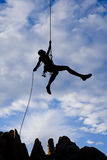Rock climber rappelling. Stock Image
