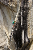Rock climber reaching. Stock Photos