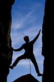 Rock climber reaching. Stock Photo