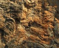 Rock climber resting during hard climb.