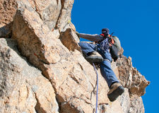 The rock-climber during rock conquest Stock Photography