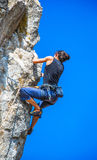 The rock-climber during rock conquest Stock Photos