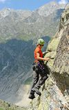 The rock-climber during rock conquest Royalty Free Stock Image