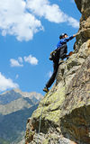 The rock-climber during rock conquest Royalty Free Stock Photo