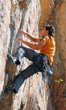 The rock-climber during rock conquest Stock Photo