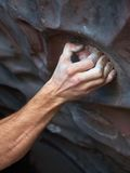 Rock-climber's hand Stock Images