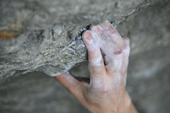 Rock climber's hand on handhold Stock Images