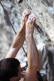 Rock climber's hands on a cliff. Closeup view of a rock climber's hands on a cliff Royalty Free Stock Photography