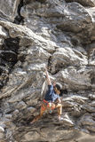 Rock climber scaling a wall. Stock Photography