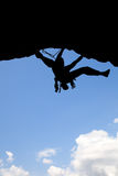 Rock climber silhouette in a sunny day Stock Photos